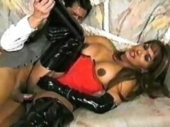 Man fucks tranny in latex