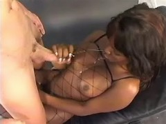 Hot black shemale gets cum from guy