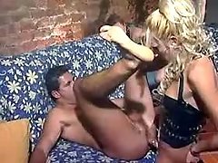Two guys do girl and tranny on sofa